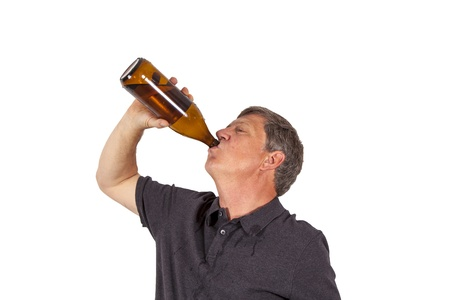 single beer bottle: man drinking out of a bottle Stock Photo