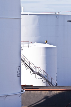 white tanks in tank farm with blue clear sky photo