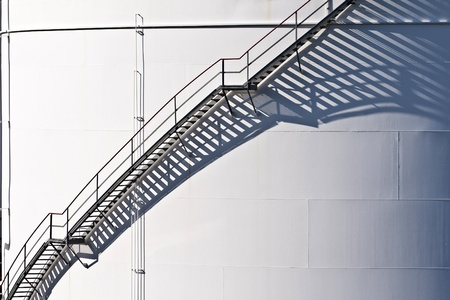 white tanks in tank farm with iron staircase photo