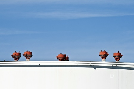white tanks in tank farm with blue clear sky Stock Photo - 13566581