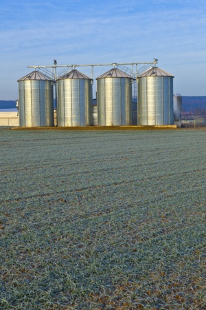 silos in the middle of a field in wintertime Stock Photo - 13567601