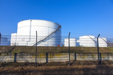 white tank in tank farm with blue sky photo