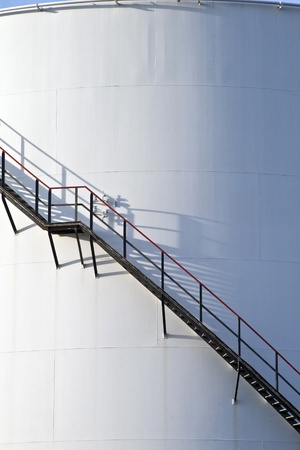 industrial stair at white tank in tank farm photo