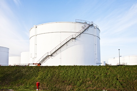 white tanks for petrol and oil in tank farm with blue sky photo