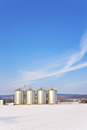beautiful landscape with silo and snow white acre with blue sky Stock Photo - 13566996