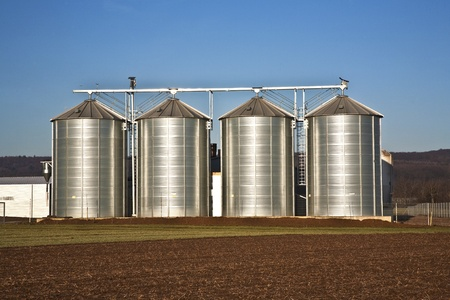 beautiful landscape with silo and acre with blue sky photo
