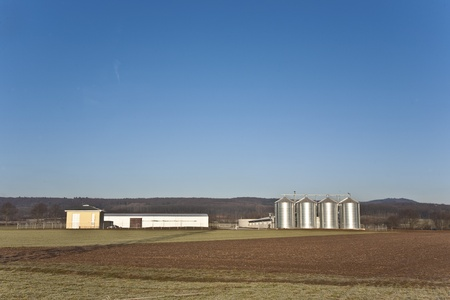 beautiful landscape with silo and field with blue sky photo