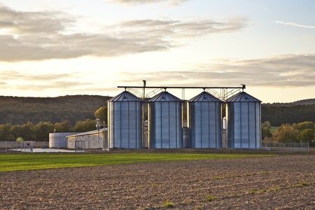 Silos in sunset with beautiful view over acres photo