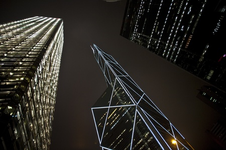 facade of skyscrapers downtown  by night photo