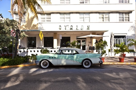 old buick in front of Art Deco Hotel AVALON in South Miami Stock Photo - 13575764