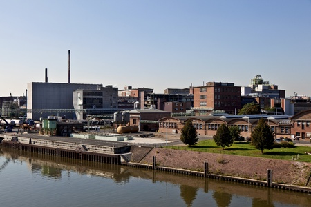 old industrial building at the river Stock Photo - 13580595
