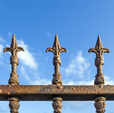 rusty fence under blue sky photo