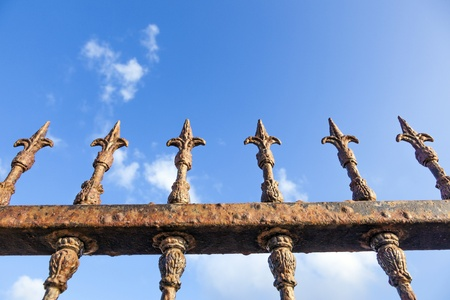 rusty fence under blue sky Stock Photo - 13576880