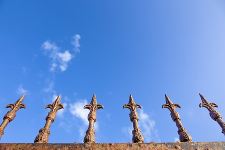 rusty fence under blue sky Stock Photo - 13576878