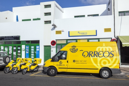 PLAYA BLANCA, SPAIN - APRIL 3: early morning view to the Post Office on April 03,2012 in Playa Blanca, Spain. For post distribution spanist correos use mainly motos instead of cars.