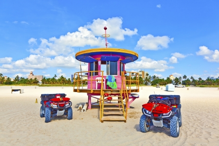 wooden colorful beach watch hut at the beautiful white beach photo