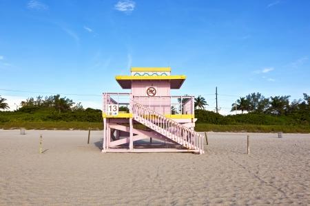 wooden bay watch hut at the beach photo