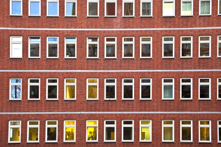 facade of office building in the evening with illuminated windows Stock Photo - 13663295