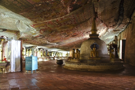damsels: Buddah and painting in the famous rock tempel of Dambullah, Sri Lanka
