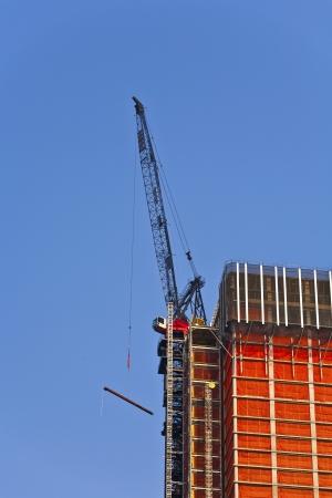 crane on skyscraper in New York Stock Photo - 13769897