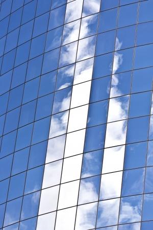 upper floor: facade of Skyscraper with reflection of sky in New York Stock Photo