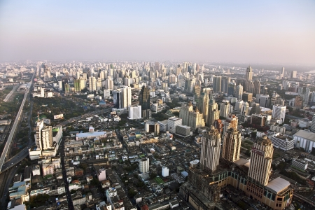 View across Bangkok skyline showing office blocks and condominiums