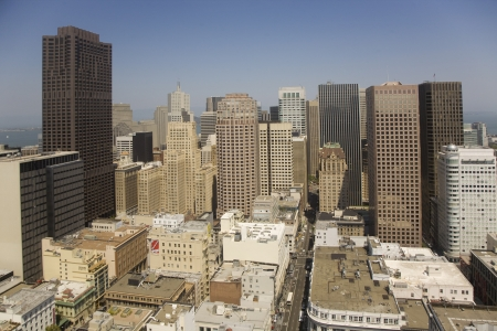 Skyline of San Francisco seen from a sky scraper with blue sky
