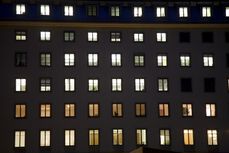 high rise buildings: windows of a business house with light by night giving a structured impression, vienna Stock Photo