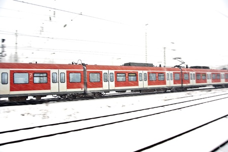 train in Wintertime on track in heavy snow flurry Stock Photo - 13776114