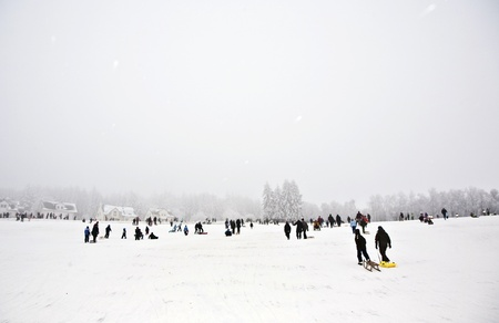 children are skating at a toboggan run in winter on snow Stock Photo - 13769921