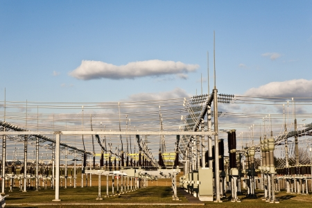 the insulator: electricity relay station with high-voltage insulator and power lines Stock Photo