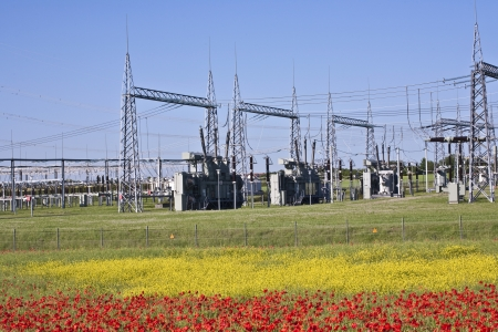 electrical power plant in beautiful colorful meadow photo