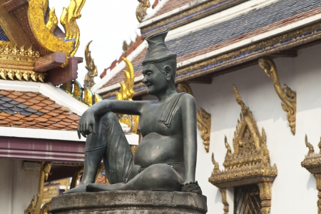 sitting figure on a stone capital in the Grand Palace, Bangkok Stock Photo - 13692353