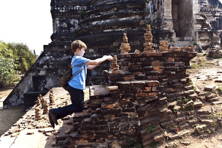 ajutthaya: boy taking picture inside the famous temple area Wat Phra Si Sanphet, Royal Palace in Ajutthaya
