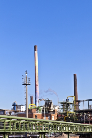 Industry park with silo and chimney photo