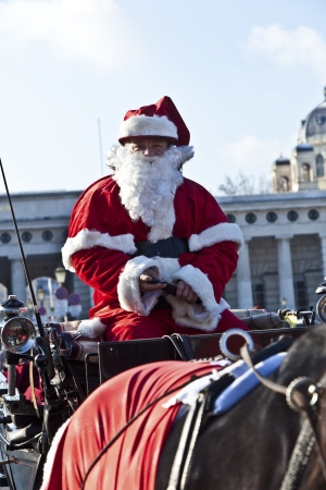 driver of the fiaker is dressed as Santa Claus in red