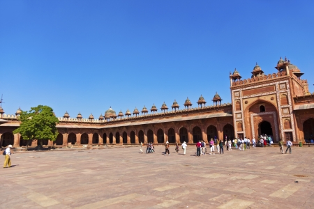 FATEPHUR SIKRI, INDIA - NOVEMBER 17: Pilgrims visit the Jama Masjid Mosque on November 17,2011 in Fatehpur Sikri, India. The mosque was constructed by Mughal emperor Akbar beginning in 1570.