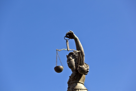 Statue of Lady Justice Justitia in front of the Romer in Frankfurt - Germany photo