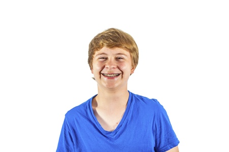 happy boy in blue shirt laughing photo