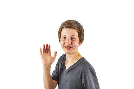 happy joyful boy gives sign photo