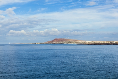 view to Playa Blanca from Playa de Papagayo (Parrot's beach) on Lanzarote, Canary islands, Spain Stock Photo - 13942889