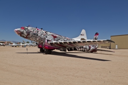 pima: TUSCON, USA - JULY 14: visiting the Pima Air and space Museum at July 14, 2012 in Tuscon, USA. This Douglas C-117 aircraft was painted by How and Nosm in 2011 in a art project.