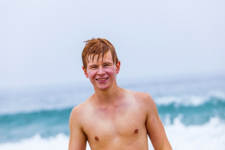 attractive young boy at the beach photo