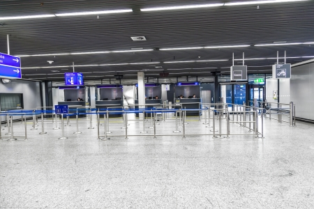 FRANKFURT, GERMANY - JUNE 8: The early shift of border control police waits for passengers in Terminal 1 at Frankfurt Rhein Main airport Gate C to check IDs on June 8,2012 in Frankfurt, Germany. Editorial
