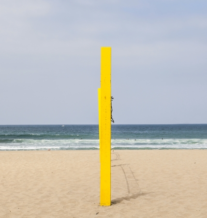 volleyball post at the beach in blue photo