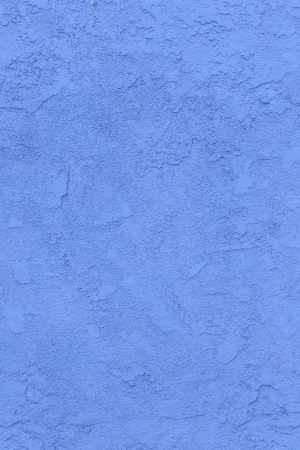 blue concrete wall with rough pattern photo