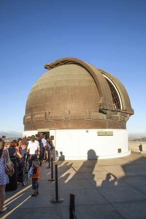 LOS ANGELES, USA - JUNE 24: famous Griffith observatory is open to watch the  moon constellation on June 24, 2012 in Los Angeles, USA. People  watch the moon with the famous  12-Inch Zeiss Refracting Telescope from 1931.