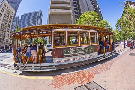 SAN FRANCISCO - JUNE 20: Famous Cable Car Bus near Fishermans Wharf on June 20, 2012 in San Francisco, California. Cable car trains first began operating in the city in 1873.