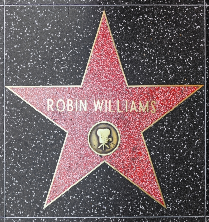 walk of fame: HOLLYWOOD - JUNE 26: Robin Williams star on Hollywood Walk of Fame on June 26, 2012 in Hollywood, California. This star is located on Hollywood Blvd. and is one of 2400 celebrity stars.