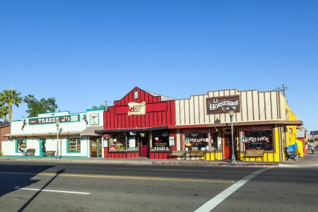 originally: WICKENBURG - USA, JUNE 14: Frontier Street in afternoon sun on June 14,2012 in Wickenburg, USA. Wickenburg was founded in 1863 by Henry Wickenburg and the Frontier street is originally preserved since that time.